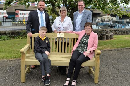 Lynn Johnston (seated right) along with grandson, Cale presented a summer seat to Larne & Inver Primary School in memory of her late husband, Rusty who was the school patrol man for approximately seven years also pictured are school principal, Kirk Patterson, Lucinda McFaul and Andy Wilson. INLT 19-001-PSB