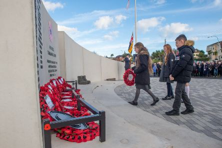 Young members of the community taking part in the wreath-laying ceremony at the new Whitehead war memorial.