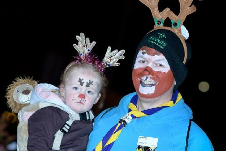 Faces painted in festive style on Friday evening.