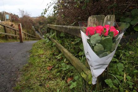 Flowers were left along the river in Larne after the tragic accident