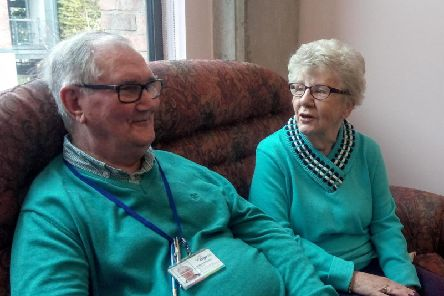 Robert Atkinson and Mabel McCracken having a chat in Age NIs day centre at the Skainos Centre