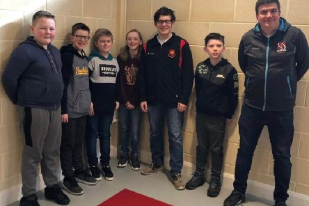 Carrickfergus Grammar principal James Maxwell with pupils from the school, all of whom enjoyed playing in their first ever chess competition.