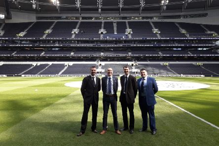 Tim is on the far left of the photo of the officials at the new stadium