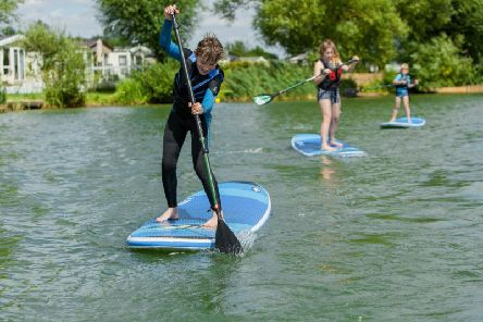 Balancing act - fun on the stand-up paddleboards at Cosgrove Park