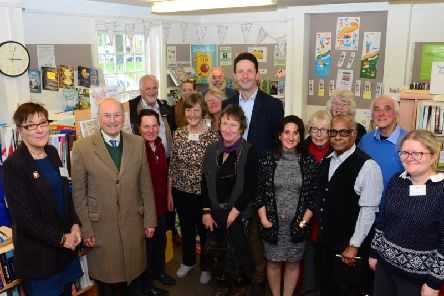 Lord Gardiner at Beacon Villages Community Library with Avril Davies (L) who chairs the library committee, local County Councillor Anne Wight, Cabinet Member Gareth Williams and his Deputy, Noel Brown,library volunteers and parish councillors