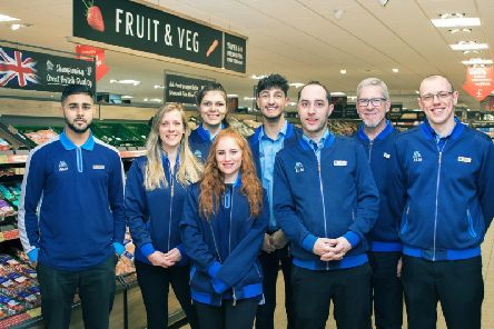 The team is ready to welcome in shoppers.