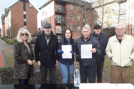 Residents of The Wharf (with Sam, middle) hold letters from AW which they received before Christmas. The letters explained the 12 hour compensation scheme. Credit: Sam.