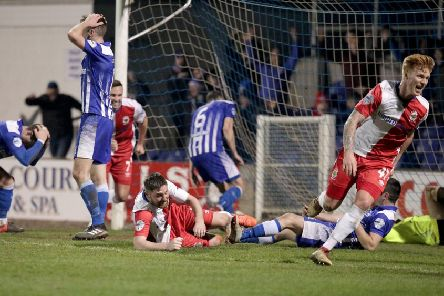 Agony for Newry City but Linfield ecstasy as Chris Casement wheels away to celebrate his last-gasp goal for league leaders Linfield. Pic by Pacemaker.