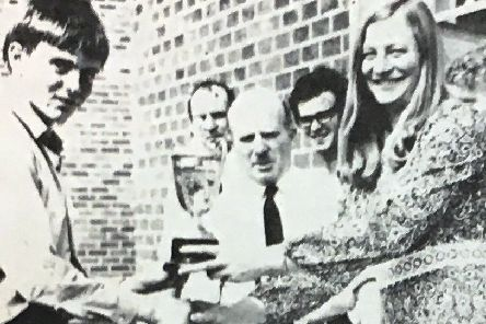 Matthew Shields receives the Victor Ludorum Cup for best athlete at Lisnagarvey High School in 1970 from Mary Peters