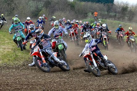 James Mackrel (65) Richard Bird (57) Jason Meara (10) Robert Hamilton (3) and John Meara (60) power through turn two at Tandragee MX1 race.