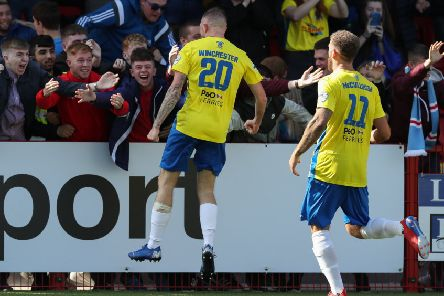 Jude Winchester celebrates his goal in front of the Ballymena United supporters. Pic by Pacemaker.