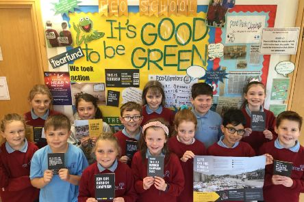 The Eco Council in front of their notice board with Tearfund's Rubbish Campaign literature. Pic by Emily Coulter/Pond Park Primary School