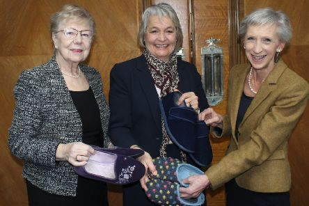 Slipper swap, county councillor Anne Jones, cabinet member Amanda Jupp and county council leader Louise Goldsmith