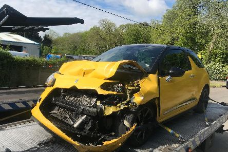 One of the vehicles damaged in the collision