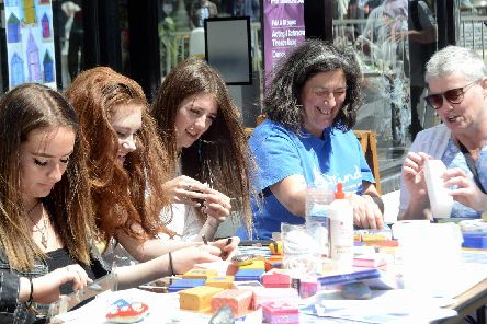 Louisa Hernandez with volunteers making up wellbeing boxes outside Colonnade House in Worthing. Picture: Kate Shemilt K190260-1