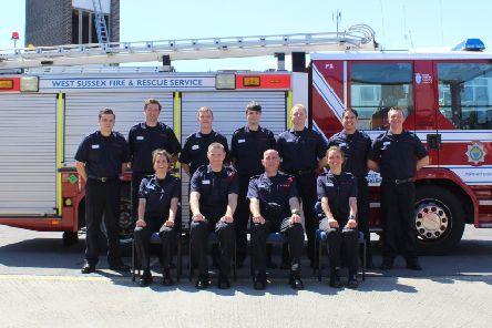 The nine new retained firefighters with their training instructors at Worthing Fire Station