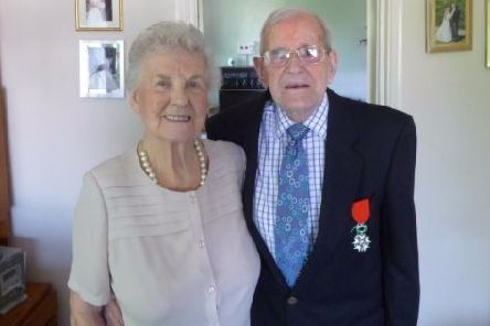 Eric Virrels, proudly diplaying his Legion d'Honneur medal, with wife Pat SUS-160512-172006003