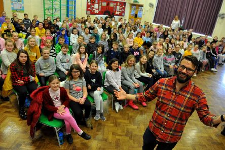 Dave Burrows, music lead at Summerlea CP School, with children from his school and four others, Rustington Community Primary School, Georgian Gardens Primary School, White Meadows Primary Academy and East Preston Junior School, at the rehearsal get-together. Picture: Steve Robards SR20011102