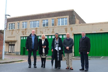 The Stagecoach depot in Bedford Row, Worthing, has been revamped.  councillor Jim Deen, Sue Belton, Worthing Society chairman, Jordan Trimby, planning enforcement officer, councillor Kevin Jenkins, the council's executive member for regeneration, and Edward Hodgson, managing director of Stagecoach.