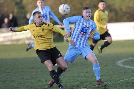 Mitch Hand (left) in action for Littlehampton Town. Picture by Stephen Goodger