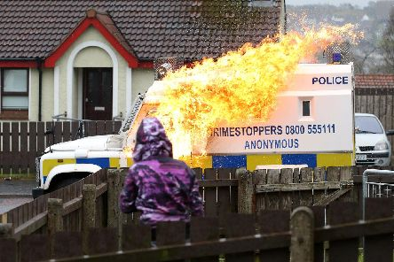 A PSNI vehicle is attacked with a petrol bomb during public disorder in Londonderry last April. Archive pic by Kelvin Boyes / Press Eye