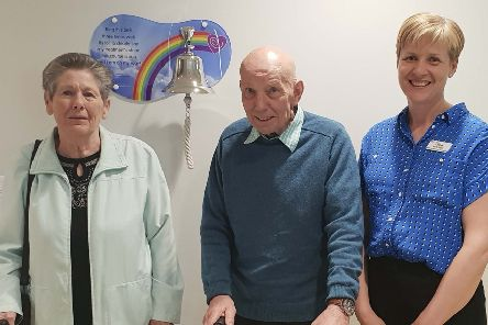 Mr John Doran and Margaret Doran from Londonderry, whose granddaughter and niece donated the bell.  Also in the picture is Lesley Mitchell Macmillan Lead Nurse, Cancer Services.