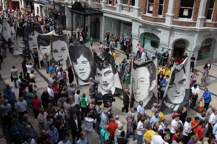 Relatives and supporters of those killed on Bloody Sunday make their way to the Guildhall in Londonderry to hear the outcome of the Saville inquiry in 2010