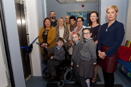 Mayor Michaela Boyle with pupil Jack Mullan preparing to cut the ribbon to officially open the Wheelchair Accessible Lift in St. Anne's PS. Included, from right, are Patricia McNutt, vice-principal, Eilis McGuinness,, principal, Kerry Lynn Mullan, Eilish Friel, Parents Association, Louise Gallagher, Karen Mullan, MLA, and John Paul Mullan. Front are pupils Brannagh McGeehan and Oran Logan-Doyle. (Photo - Tom Heaney, nwpresspics)