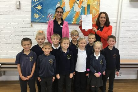Executive head teacher, Becky Dhami, and Robin class teacher and phonic lead, Katie White, alongside some of the successful pupils.