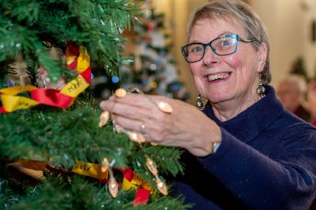 Pat Whitley popping lights on a Christmas Tree at last year's festival.