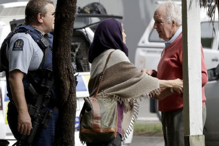 Police escort people away from outside a mosque in central Christchurch, New Zealand, Friday, March 15, 2019. Multiple people were killed in mass shootings at two mosques full of people attending Friday prayers, as New Zealand police warned people to stay indoors as they tried to determine if more than one gunman was involved. (AP Photo/Mark Baker)