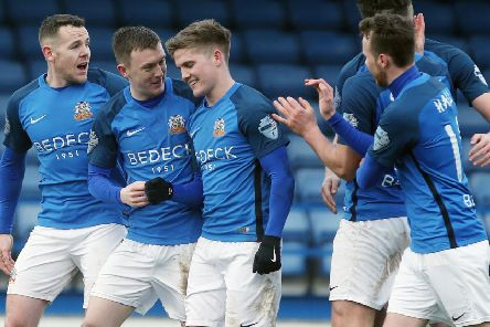 Josh Daniels (centre) and Glenavon team-mates celebrate the game's only goal on Saturday against Dungannon Swifts. Pic by  INPHO.