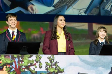Pictured presenting their cross-community project on the main stage at the Esri International User Conference in San Diego are (L-R): Leon Van Der Westhuizen, Lurgan Junior High School; Aiesha Mouhsine, St. Ronan's College; and Hannah Trew, Lurgan College.