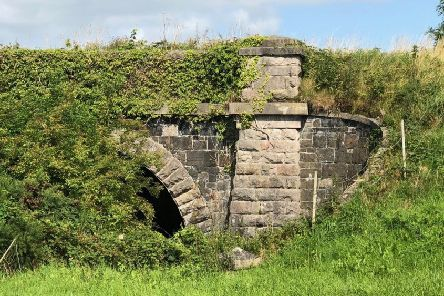 Despite it being 62 years since the last train used the line, much of the infrastructure is still intact, as can be seen at Chapel Bridge.  A bit overgrown, but it was clearly built to last!