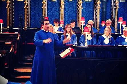 Simon Neill conducting the choir at Westminster Abbey