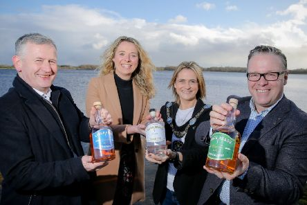 Pictured on the shores of Lough Neagh with the Lord Mayor of Armagh City, Banbridge and Craigavon, Councillor Mealla Campbell, are (from left) Lough Neagh Distillers' Managing Director Max Hayes, Spirits Portfolio Director Sorcha Mulholland and Founder and Owner Vernon Fox.'Picture: Philip Magowan