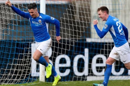 Danny Purkis heads off to celebrate his goal for Glenavon against Glentoran. Pic by INPHO.