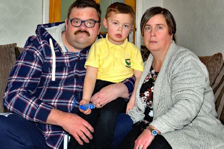 Edenderry Primary School Special Unit pupil, Ryan Calvert (4) who was left on a school bus alone for a number of hours pictured with his parents John and Gillian. INPT09-207.