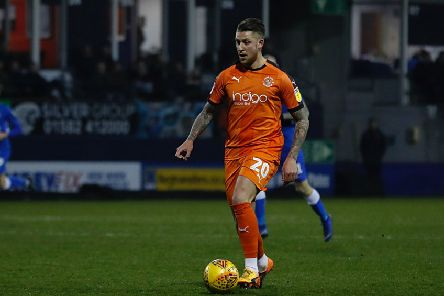 George Moncur on the ball for Luton