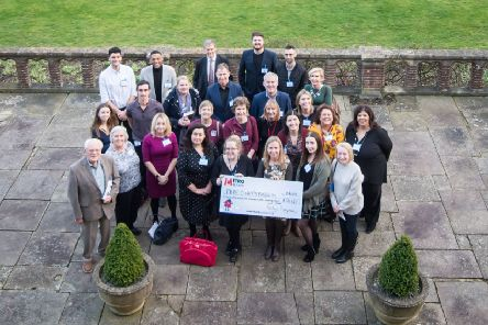 Representatives of the 17 selected charities receive a cheque at a celebratory closing event