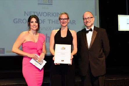 L-R Becky Ives (MC) Kate Cherry (The Athena Network) and Paul Adams (Bedford Borough Council) on stage at the SME Luton & Bedfordshire Business Awards 2019, the Bedford Corn Exchange, Bedford.