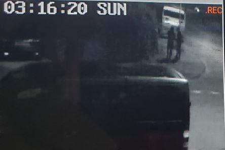 A screen shot from Kris's CCTV showing the two men by the hedge.