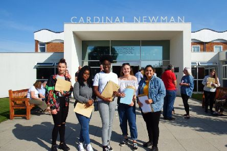 Happy Cardinal Newman pupils celebrate their success