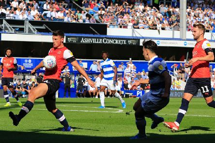 Matty Pearson makes a block as Town came under intense pressure at QPR on Saturday