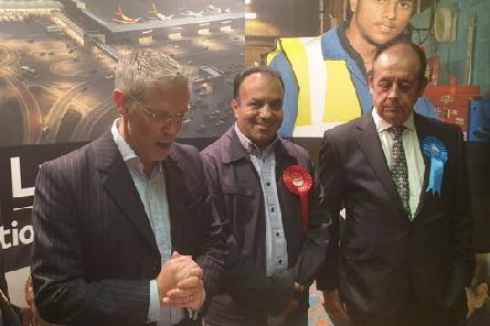 Returning Officer Robin Porter announces Asif Masood's success for Labour. Photo:Luton Council