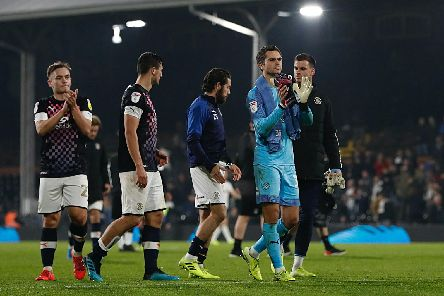 Luton player applaud their supporters after losing 3-2 at Fulham last month