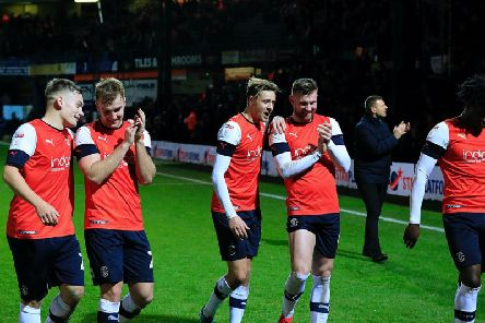 Town's players celebrate their 2-1 win over Wigan
