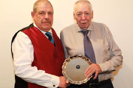 Caistor Cricket Club chairman Ben Jacob presents Wes Allison with a special award for 57 years service to the club. Picture: Gareth Johnson EMN-181015-104058002