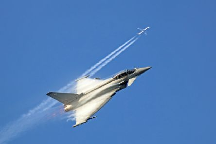Perfect timing as the Typhoon climbs and crosses the vapour trail of a passing jet. EMN-190218-124038001