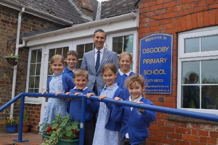 Head teacher Ashley Taylor and some of the pupils EMN-190618-104812001